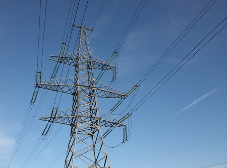 Electric power lines against blue sky. photo