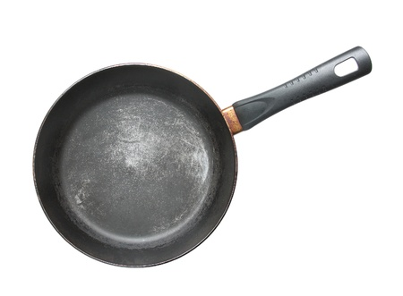 Old frying pan isolated on a white background. photo