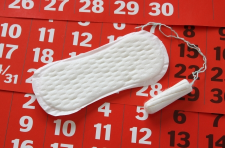 tampon: The sanitary napkin lying on a red calendar. Stock Photo