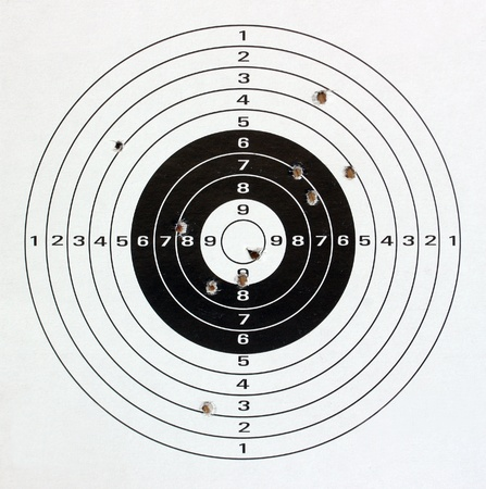 Paper target with holes close up. photo