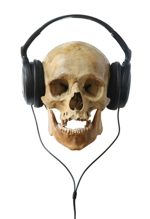 Human skull in headphones isolated on a white background. photo