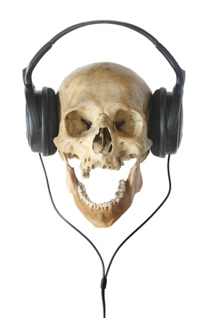 Human skull in headphones isolated on a white background. Stock Photo - 14652587