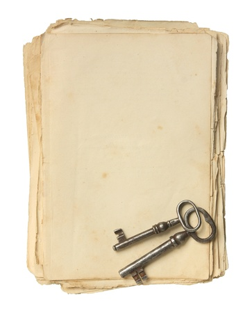 Old paper and keys isolated on a white background  photo