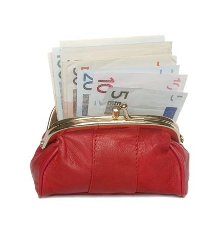 billets euros: Plein portefeuille rouge sur un fond blanc.