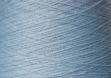 Background. The coil with woolen threads close up. Stock Photo