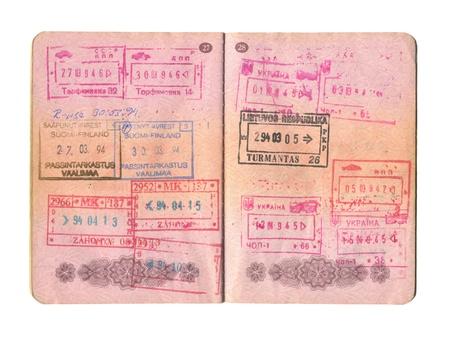 foto carnet: El pasaporte abierto con los sellos de cerca.
