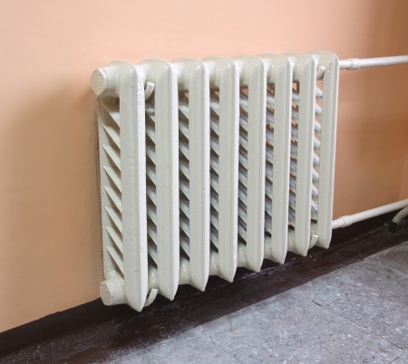 heater: Heating radiator on pink wall in a room. Stock Photo