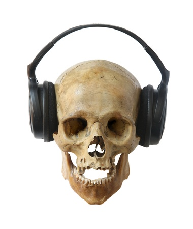 detestable: Human skull dj in headphones isolated on a white background.