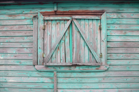 Old window on a wooden wall. photo