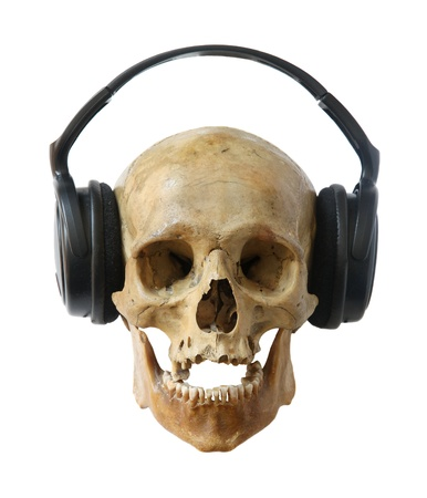 Human skull dj in headphones isolated on a white background. photo