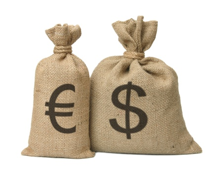 Bag from a sacking with dollars isolated on a white background. Stock Photo