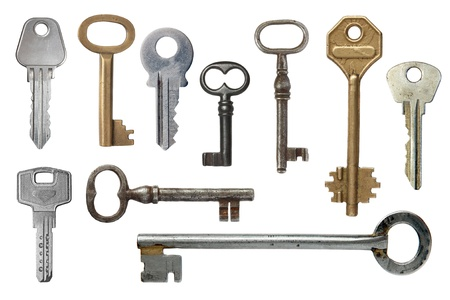 Keys from door locks on a white background. photo