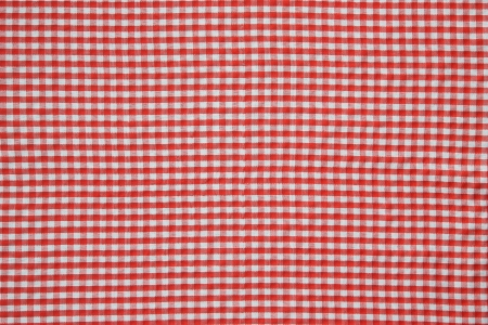 It is red a white tablecloth close up. 版權商用圖片