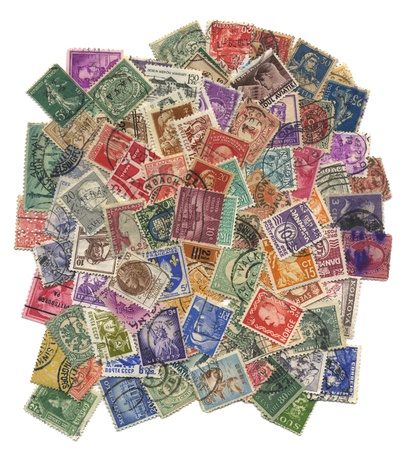 Stamps mail of the different countries on a white background. Foto de archivo