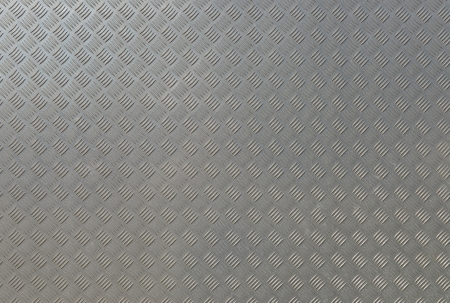 A background of old aluminum diamond plate. photo