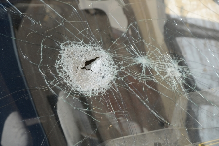 The broken glass of the car close up.