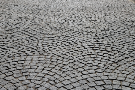 Abstract background of old cobblestone pavement. photo
