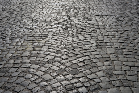 cobblestone street: Abstract background of old cobblestone pavement. Stock Photo