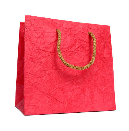Red paper package isolated on a white background.