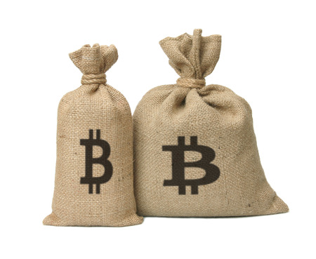 Bags from bitcoin isolated on a white background. Stock Photo