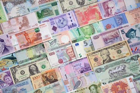 global currencies: Background from paper money of the different countries.