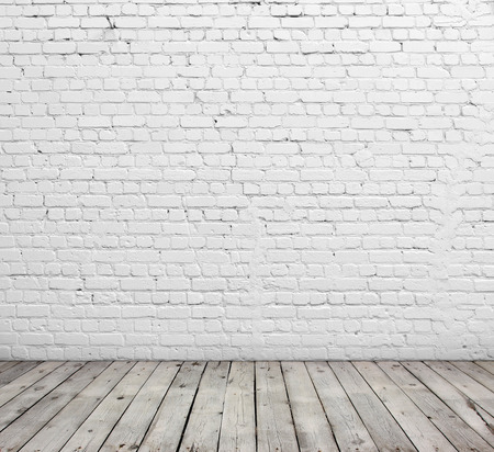 Old white brick wall and wood floor. Stock Photo - 30542631