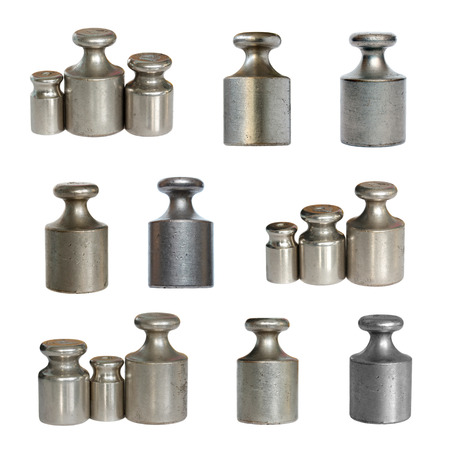 standard steel: Calibration weights isolated on a white background. Stock Photo