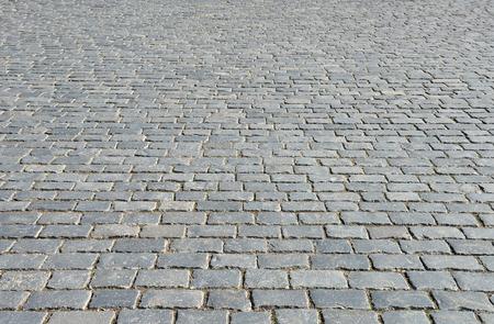 empedrado: Resumen de antecedentes de pavimento de adoquines de cerca.
