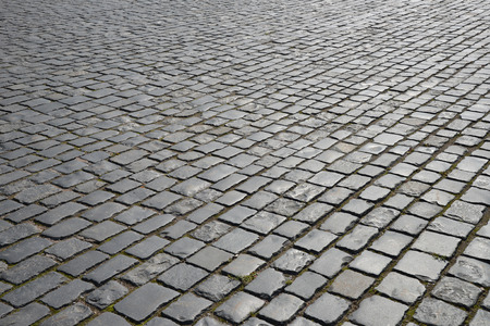 Abstract background of old cobblestone pavement close-up. photo
