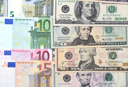 Background from different banknotes of dollars and euro close up. Stock Photo