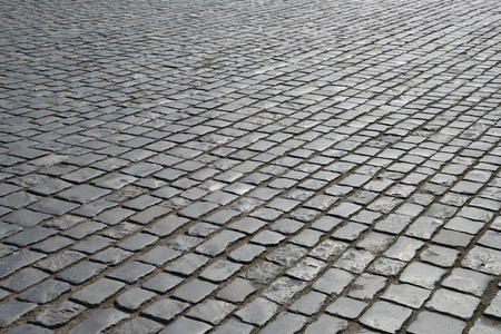 cobble: Abstract background of old cobblestone pavement close-up. Stock Photo