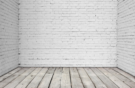 wood room: Old white brick wall and wood floor.