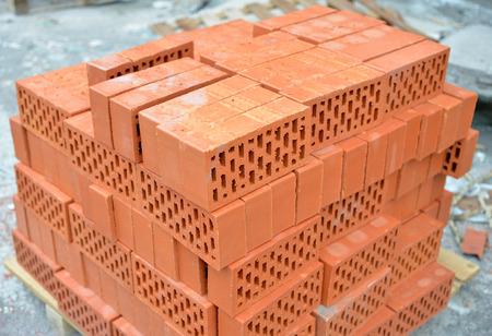 heap up: Big heap of red bricks close up. Stock Photo