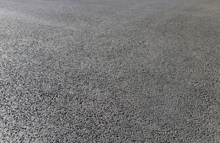 surface level: Abstract background. New black asphalt close up.