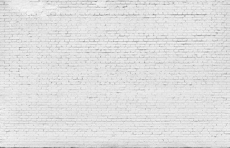 painted wall: Background. Brick wall painted with white paint.