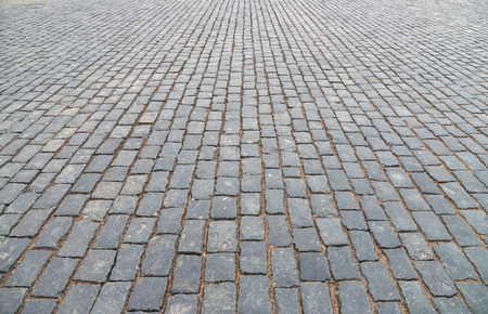 black stone: Abstract background of old cobblestone pavement close-up. Stock Photo