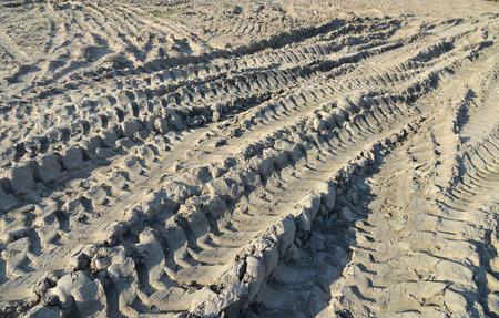 treads: Traces of tires on a dirt road. Stock Photo