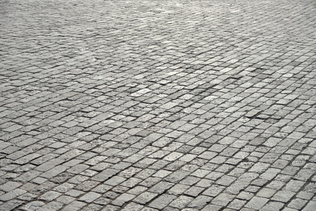 pavement: Abstract background of old cobblestone pavement close-up. Stock Photo