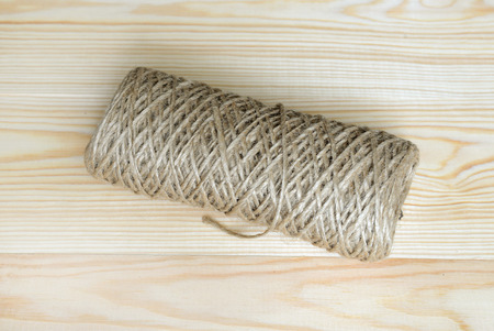 twine: Roll of a twine jute on a wood. Stock Photo