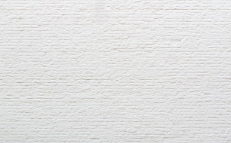 Background old brick wall covered white plaster.