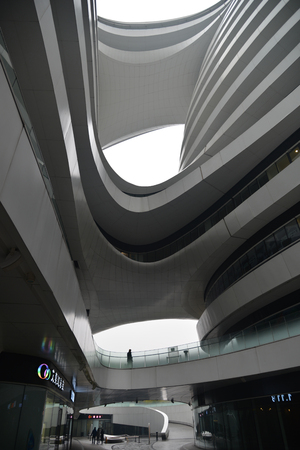 building exteriors: BEIJING, CHINA - NOV 20, 2015: SOHO Galaxy office building, architect Zaha Hadid.