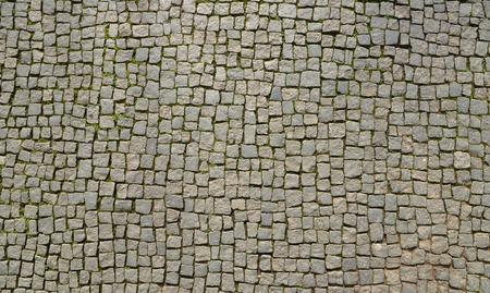 Abstracte achtergrond van de oude geplaveide stoep van bovenaf