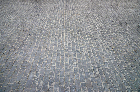 Abstract background of old cobblestone pavement close-up. Stock Photo