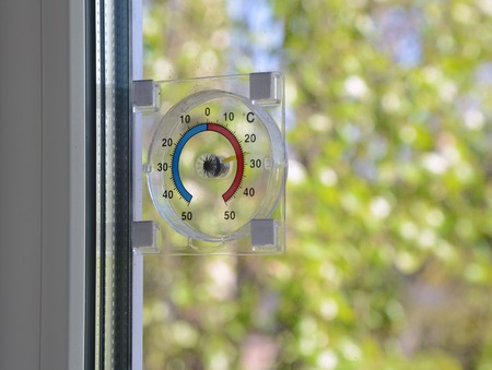 Thermometer on the window. Summer background