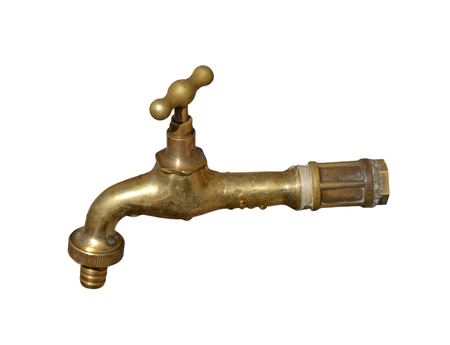 The old brass tap isolated on a white background.