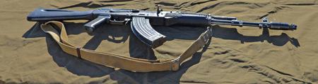 AK-47 assault rifle on a green background.