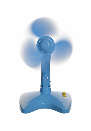 The plastic blue fan isolated on a white background. Reklamní fotografie