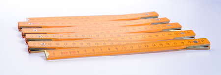 Yellow carpenters ruler on a white background Stockfoto