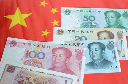 Chinese money Renminbi on a red background.
