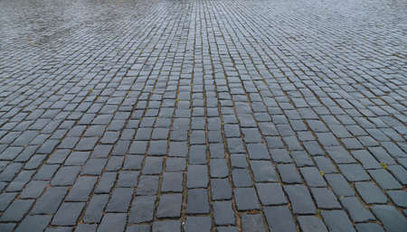 Abstract background. Old cobblestone pavement close-up. Stock Photo